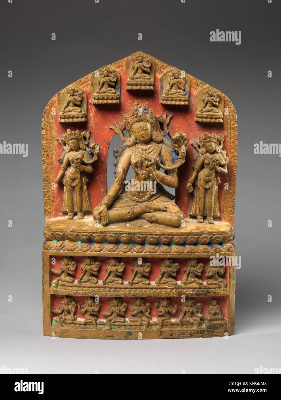 White Tara, Accompanied by Twenty-One Emanations. Date: 14th century; Culture: Tibet; Medium: Stone with polychrome; - Stock Image