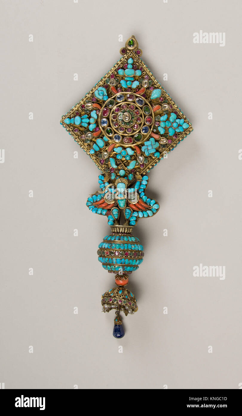 Ear Ornament for a Deity. Date: 17th-19th century; Culture: Nepal; Medium: Mercury, gilt silver, rubies, emeralds, Stock Photo