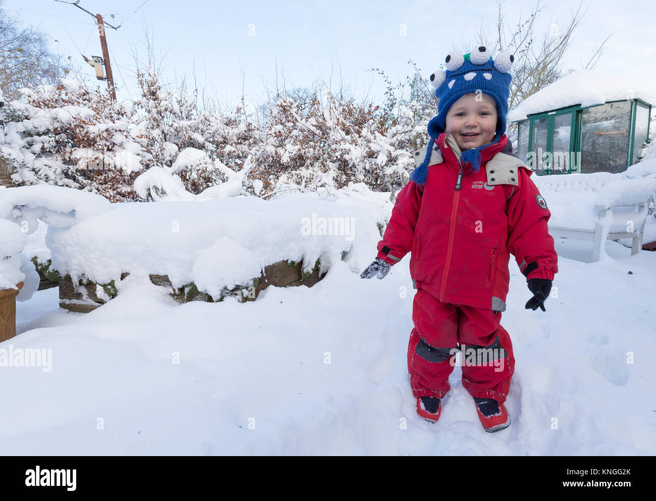 First snow in this 3-year old boys life! Out in the garden in Herefordshire, UK. - Stock Image