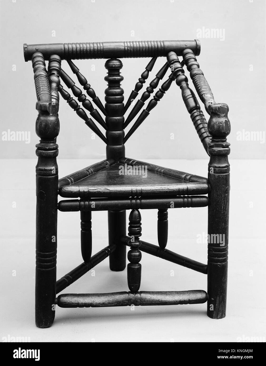 Three-legged chair. Date: late 16th-early 17th century; Culture: British; Medium: Ash with oak seat; Dimensions: Stock Photo