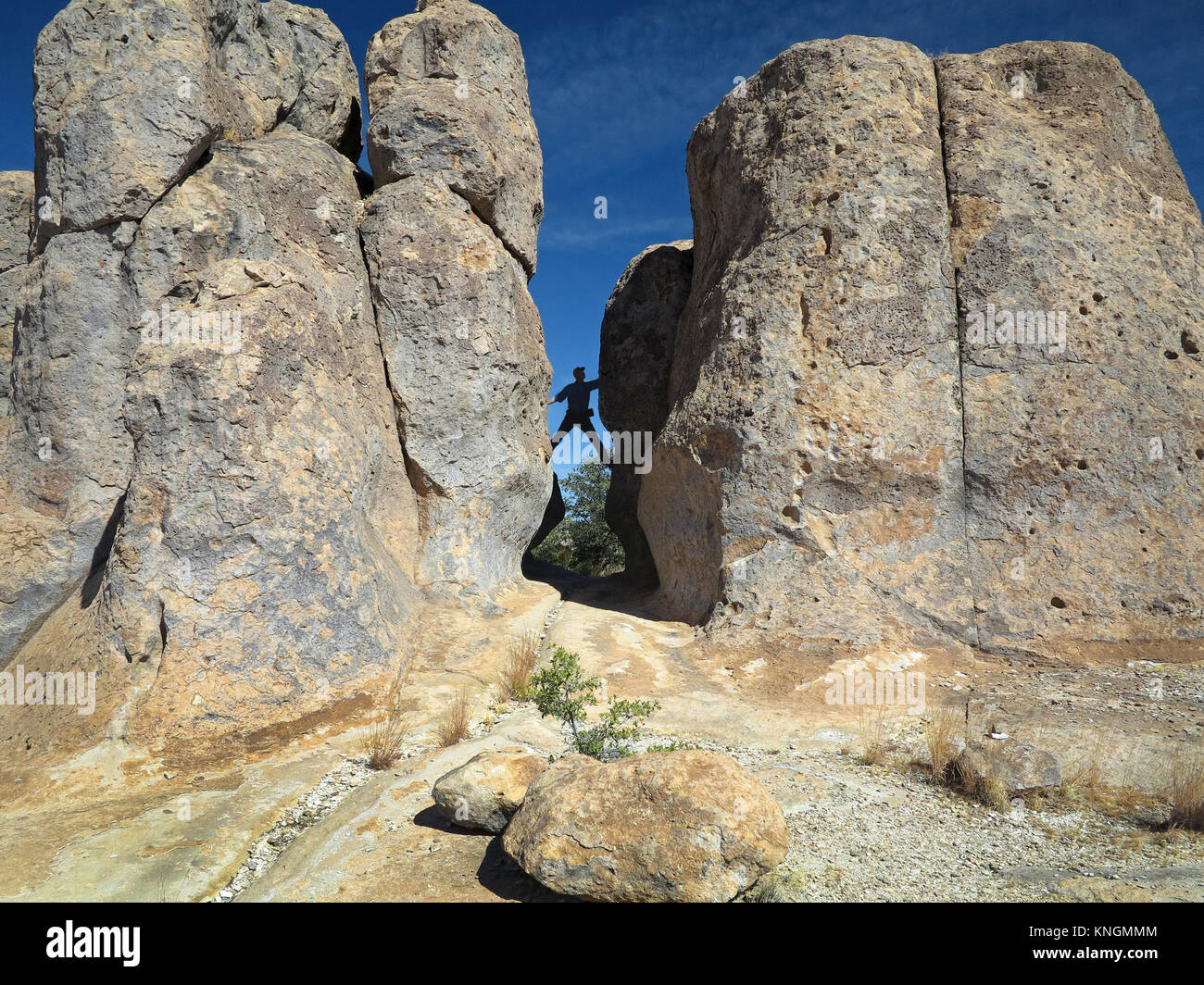 Geological formations at City of Rocks, NM. Climbing between a rock and a hard place. - Stock Image