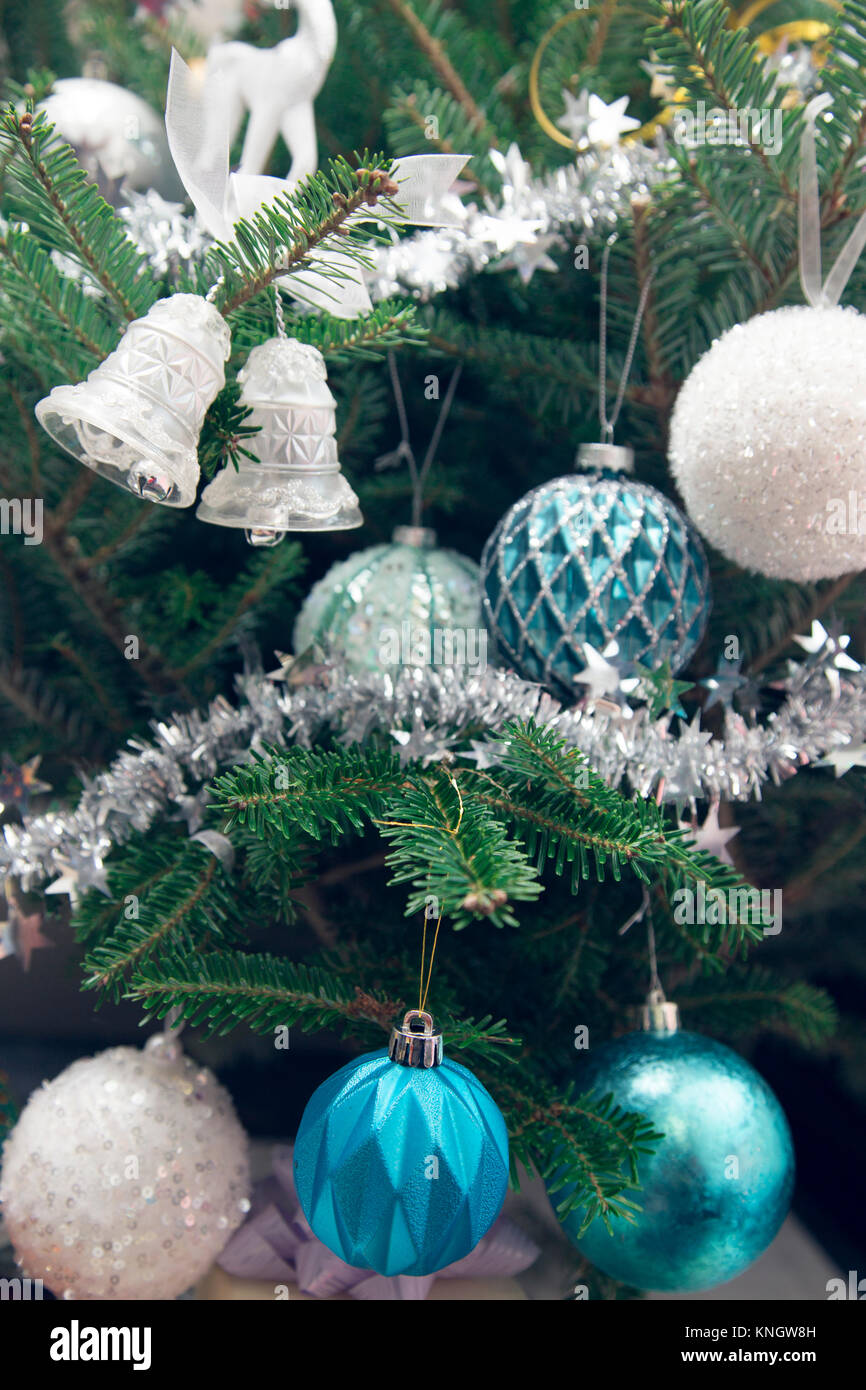 Christmas Tree Decorated With Blue And White Glitter Balls Toy Bells Stock Photo Alamy
