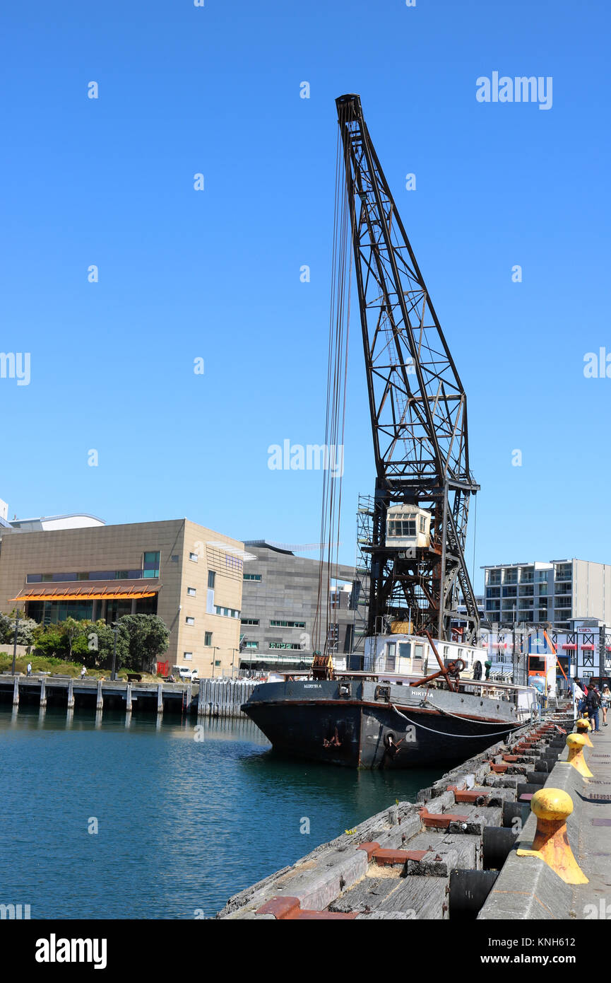 The Hikitia is a working self-propelled floating steam crane that is docked at the Taranaki Street wharf in Wellington - Stock Image