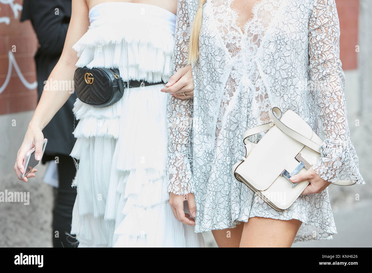 MILAN , SEPTEMBER 24 Women in white with Gucci pouch and