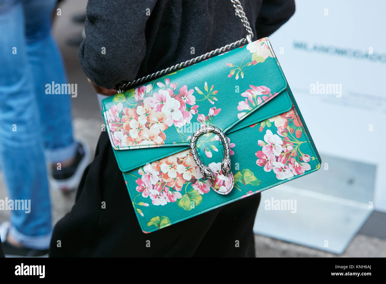 5f8bde05e8b MILAN - SEPTEMBER 24  Woman with green Gucci bag with floral design before  Trussardi fashion