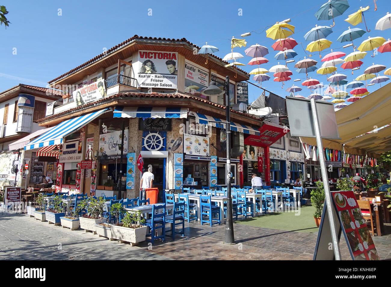 Gastronomy at umbrella street, 2.Inoenue Sokak, Kaleici, old town of Antalya, turkish riviera, Turkey Stock Photo