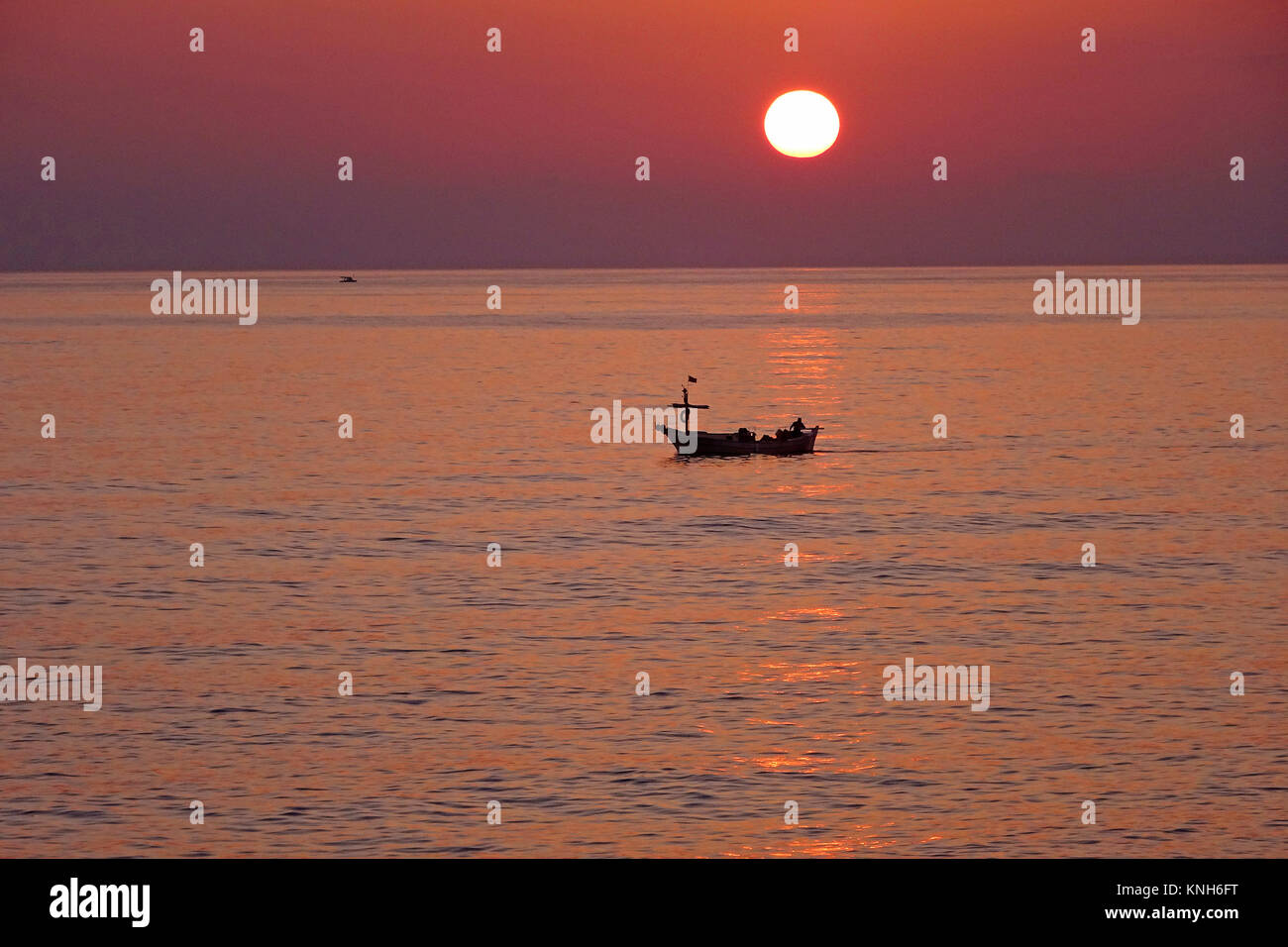 Small fishing boat on sea at sunset, Alanya, turkish riviera, Turkey Stock Photo