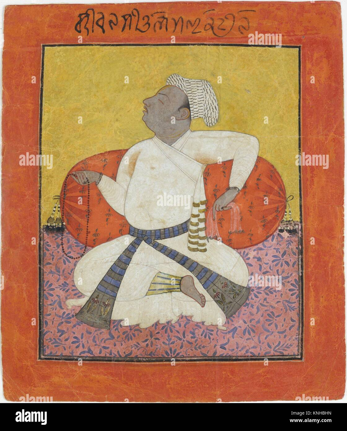 Maharaja Sital Dev in Devotion. Date: ca. 1690; Culture: India (Punjab Hills, Basohli); Medium: Ink, opaque watercolor, - Stock Image