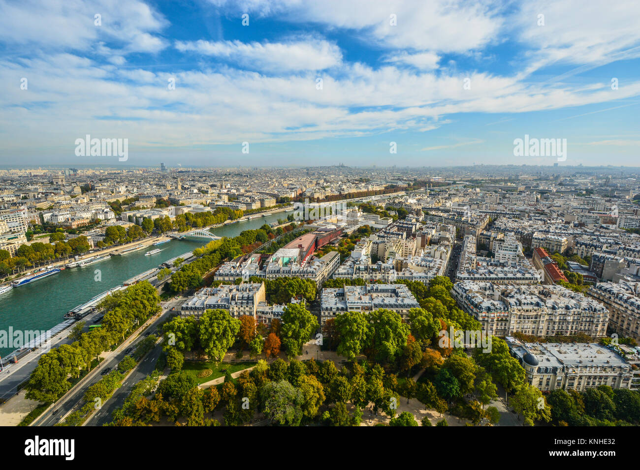 A view of the city of Paris, France including the river Seine from the platform of the Eiffel Tower on a partly - Stock Image