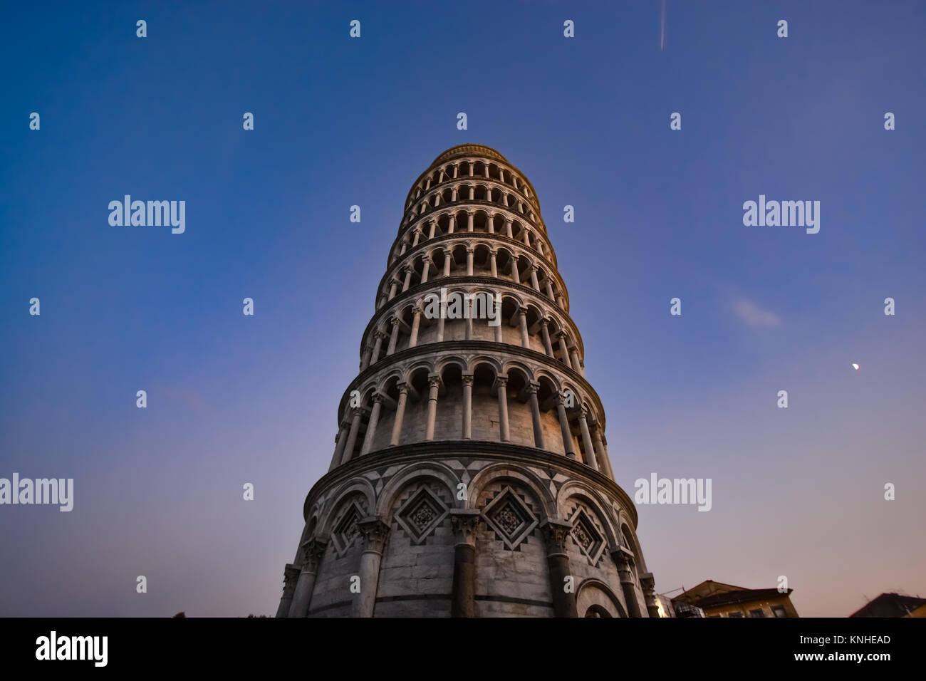 The leaning tower of Pisa, Italy in the piazza del duomo in the Tuscan region as night falls - Stock Image