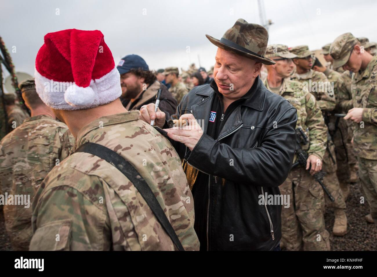 Roastmaster comedian Jeff Ross signs an autograph for a U.S. soldier during the CJCS USO Holiday Tour December 25, - Stock Image