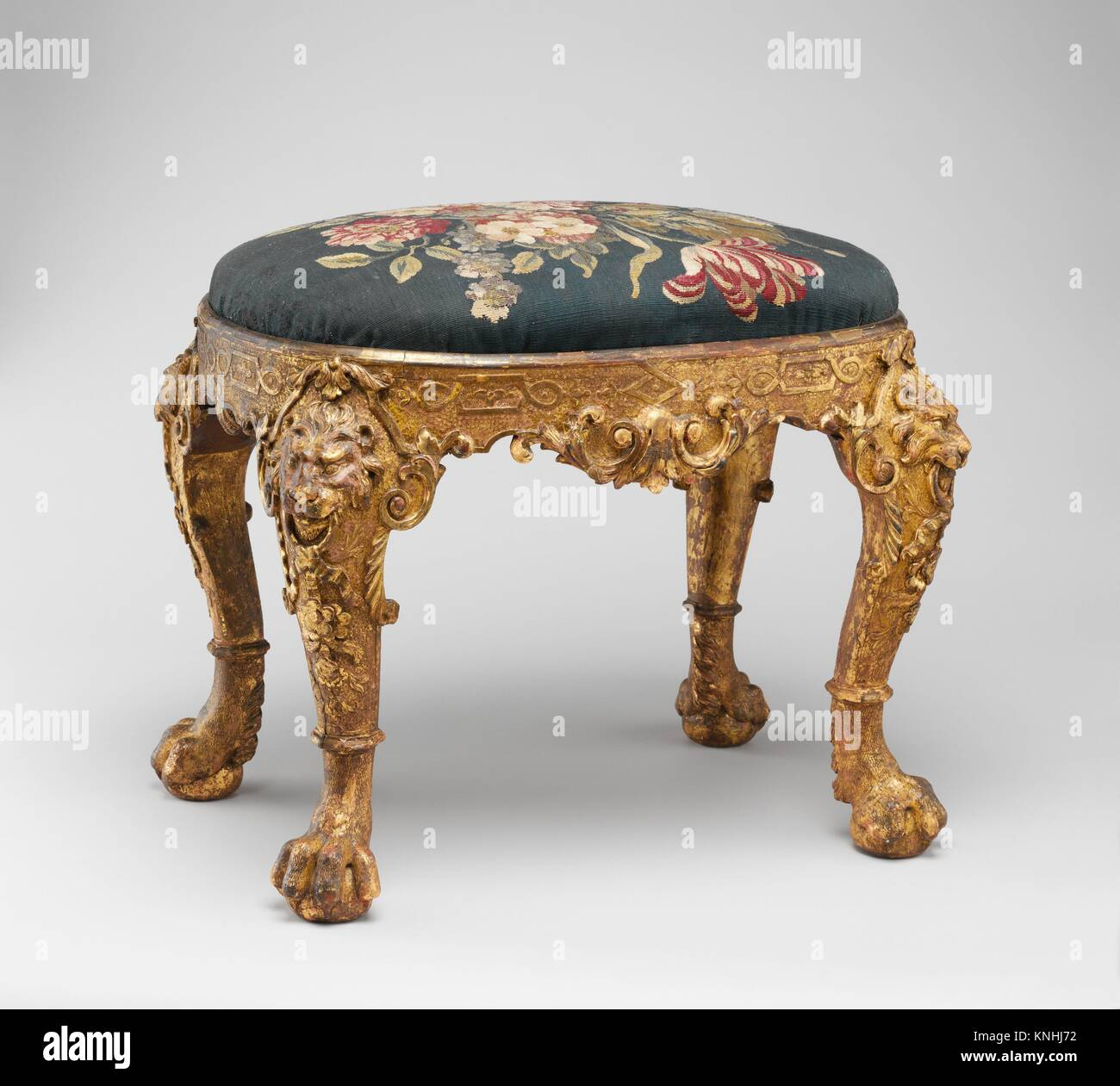 Stool. Factory: Tapestry woven at Soho; Date: ca. 1725-35; Culture: British; Medium: Gilded gesso on walnut; wool - Stock Image
