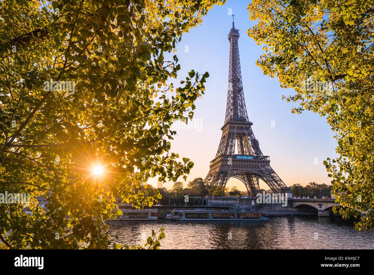 Sunrise at the Eiffel tower during autumn, Paris - Stock Image