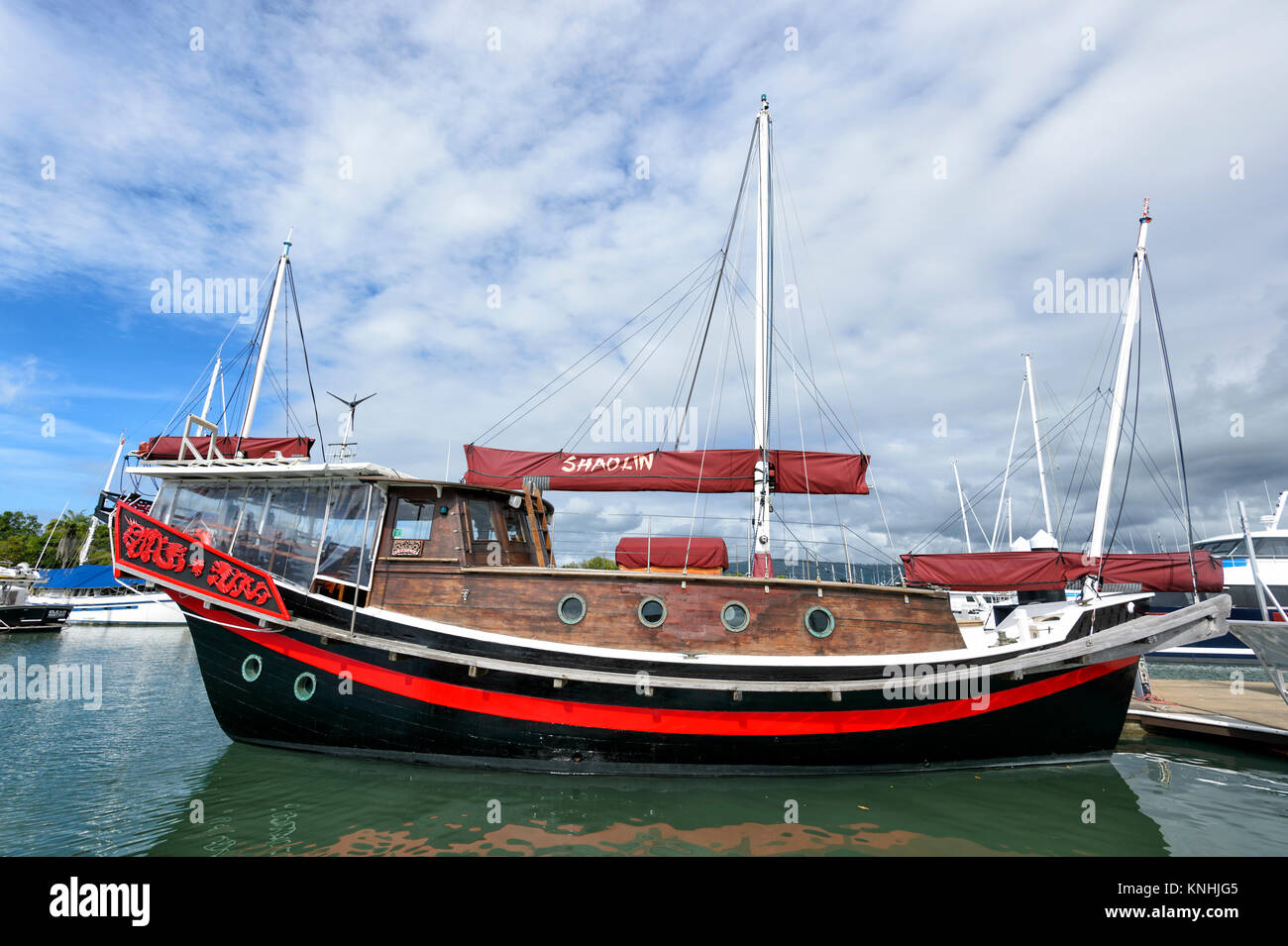 The Chinese junk Shaolin is a tourist cruise boat at the Reef Marina, Port Douglas, Far North Queensland, FNQ, QLD, - Stock Image