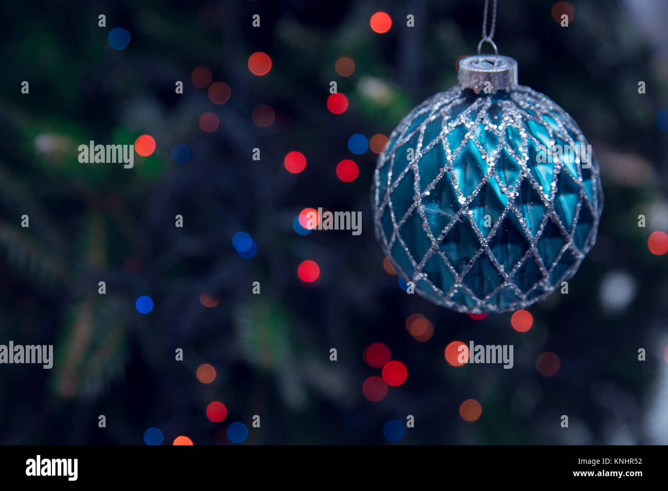 New Year bauble against dark background - Stock Image
