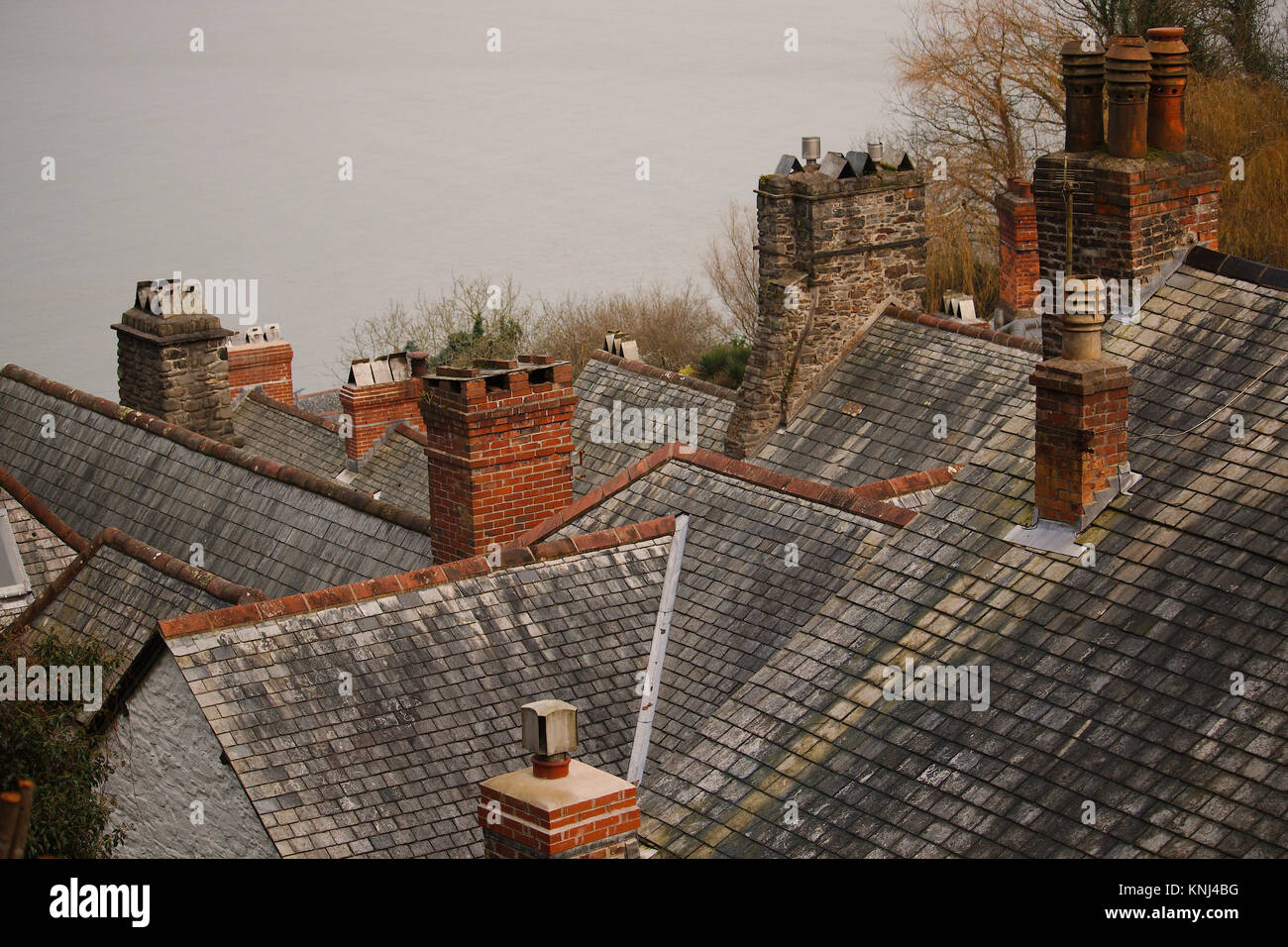Multiple chimneys on different rooftops together. - Stock Image