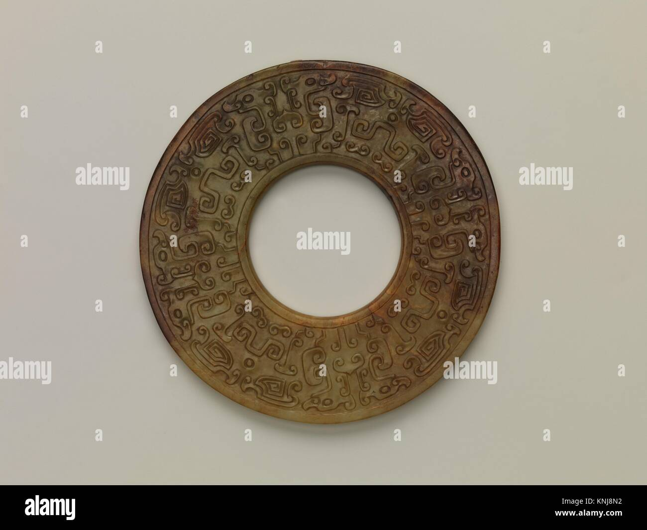 Annular Disk with Carved Designs. Period: Song (960-1279)-Qing (1644-1911) dynasty; Culture: China; Medium: Jade Stock Photo