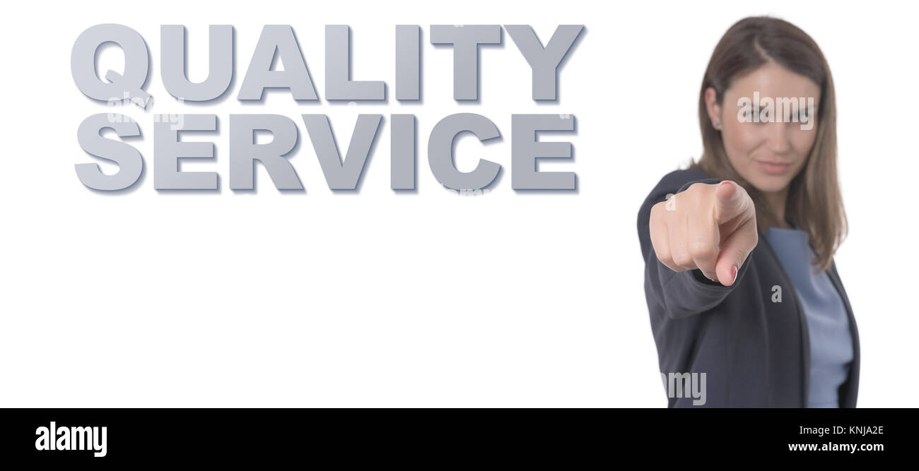 Business Woman pointing the text QUALITY SERVICE CONCEPT Business Concept. Stock Photo