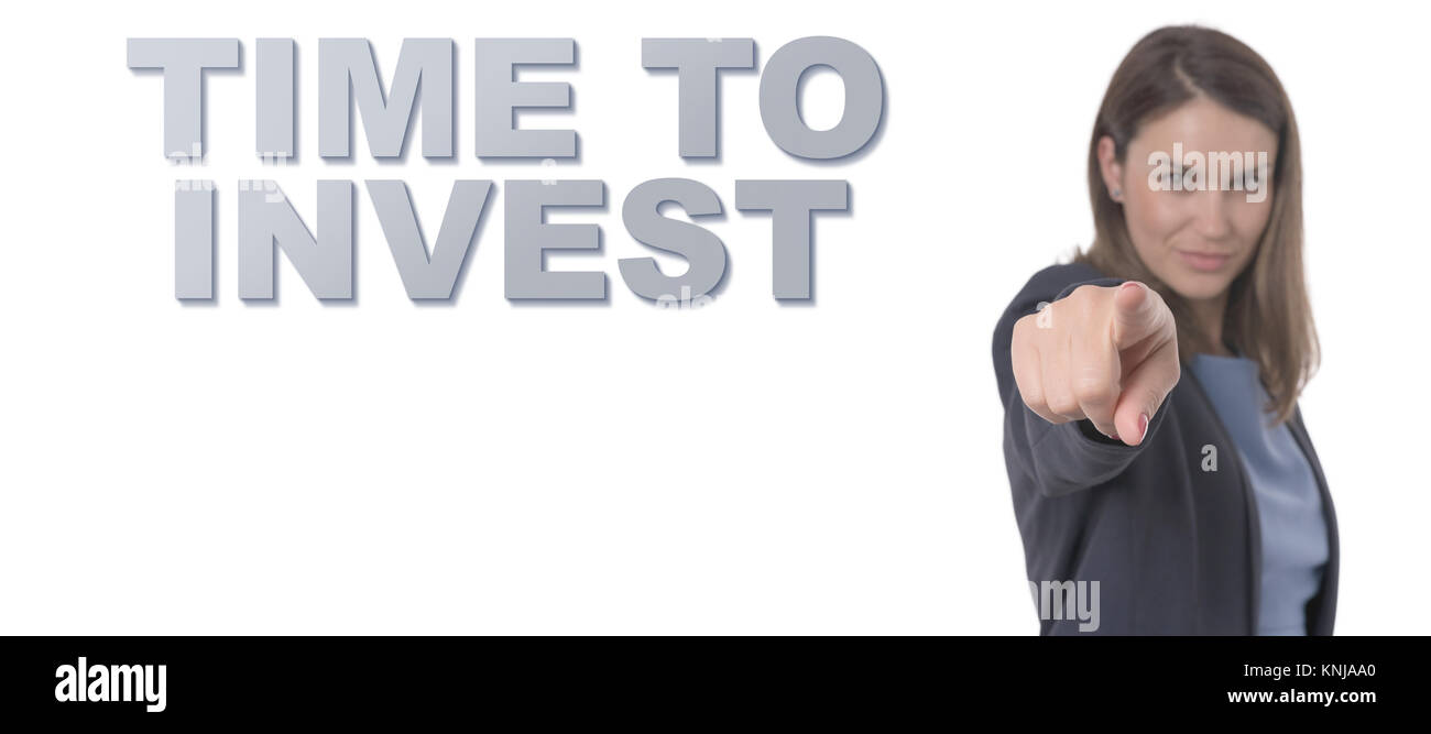 Business Woman pointing the text TIME TO INVEST CONCEPT Business Concept. - Stock Image