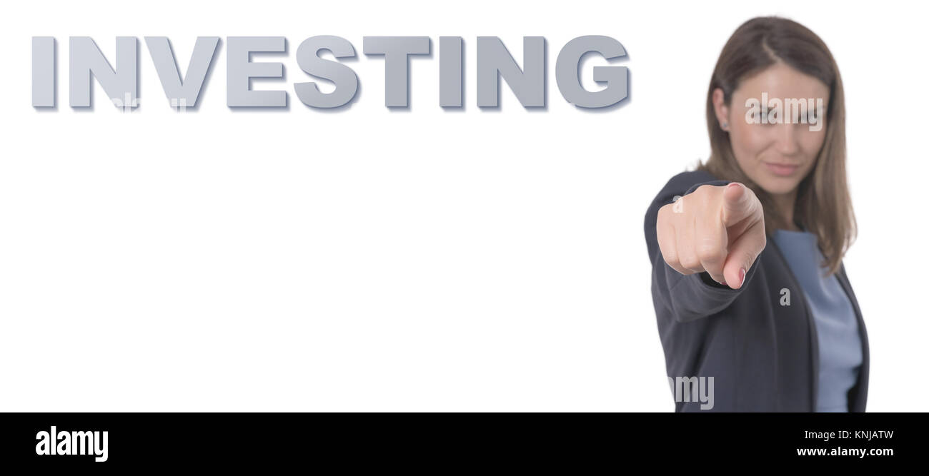 Business Woman pointing the text INVESTING CONCEPT Business Concept. - Stock Image