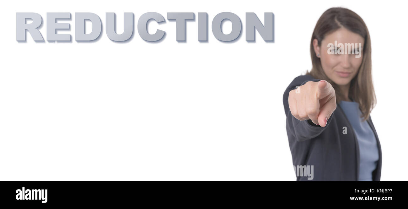 Business Woman pointing the text REDUCTION CONCEPT Business Concept. - Stock Image