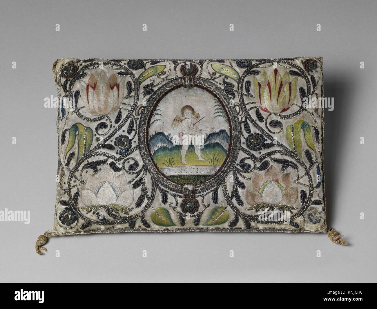 Cushion. Date: 1620-40; Culture: British or Dutch; Medium: Satin worked with silk and metal thread; satin, long - Stock Image