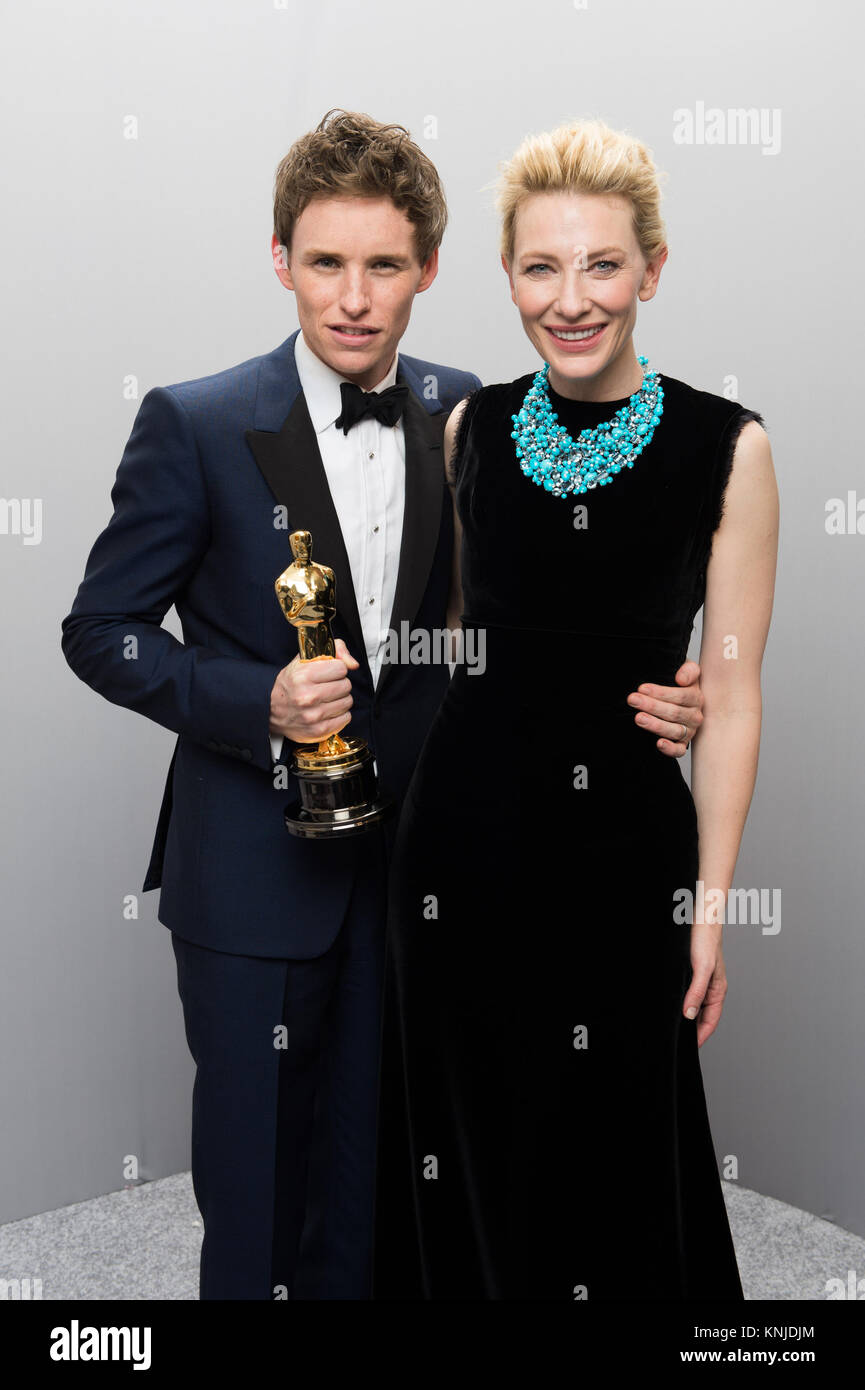 HOLLYWOOD, CA - FEBRUARY 22: Eddie Redmayne poses backstage with the Oscar® for Performance by an actor in - Stock Image