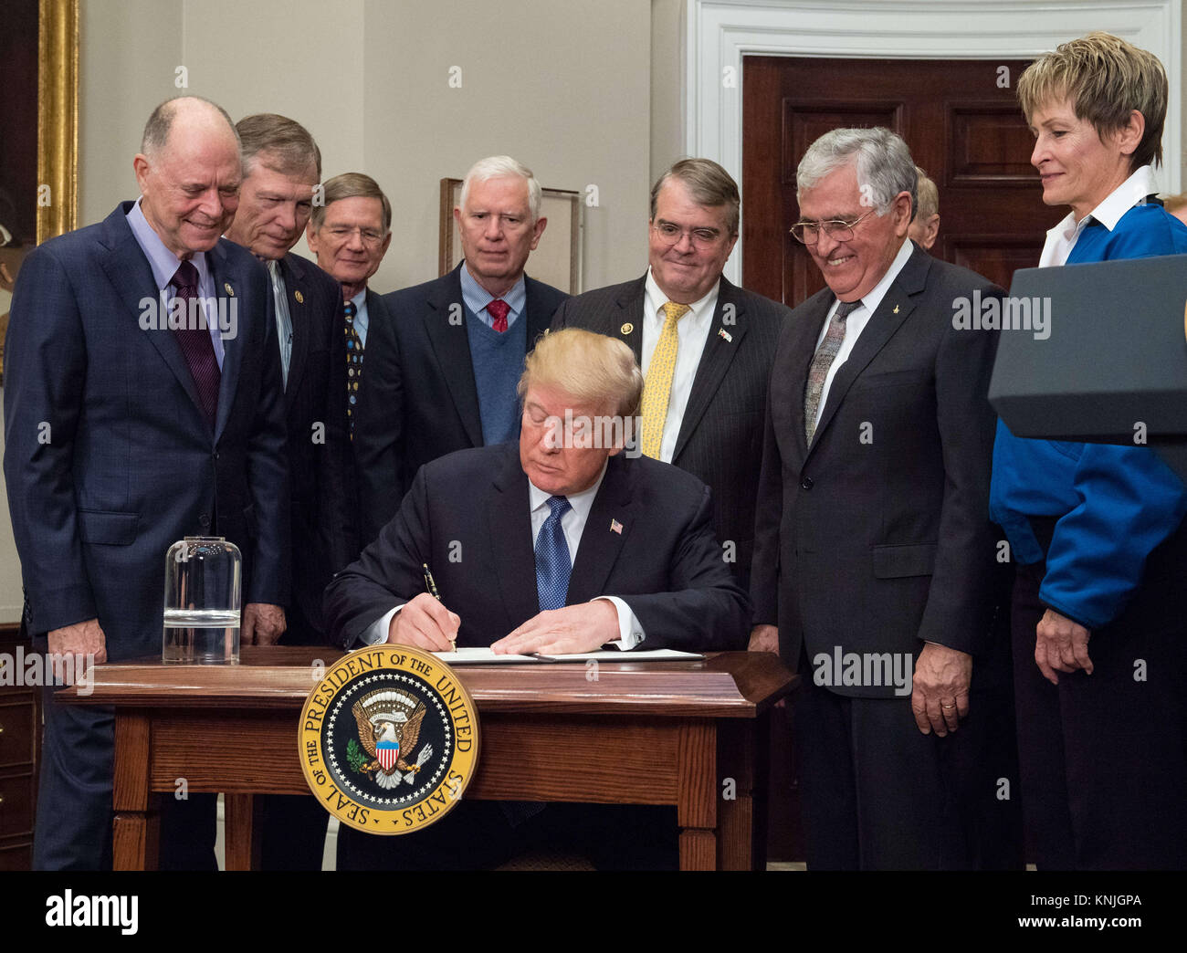 United States President Donald J. Trump signs the Presidential Space Directive. 11th Dec, 2017. 1, directing NASA to return to the moon, alongside members of the Senate, Congress, NASA, and commercial space companies in the Roosevelt room of the White House in Washington, Monday, December 11, 2017. Mandatory Credit: Aubrey Gemignani/NASA via CNP Credit: Aubrey Gemignani/CNP/ZUMA Wire/Alamy Live News Stock Photo
