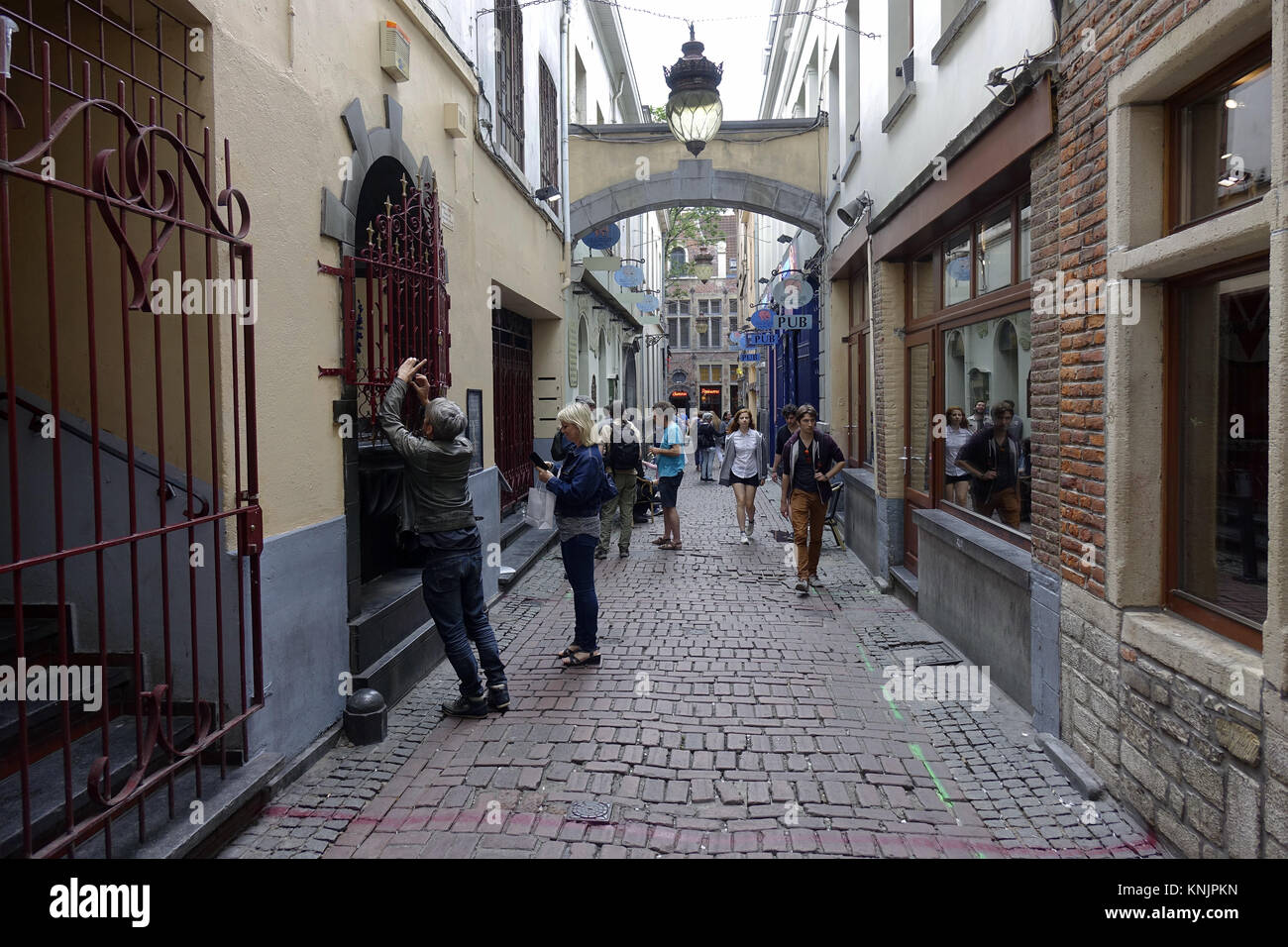 Pedestrians in the Impasse de la Fidélité in the old town of the Belgian capital Brussels, pictured on 25.06.2017. Stock Photo