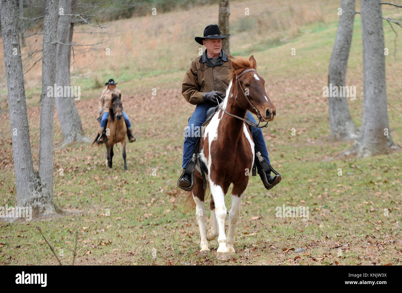 Gallant, United States. 12th Dec, 2017. Judge Roy Moore and his wife, Kayla, arrive on horseback to vote at the - Stock Image