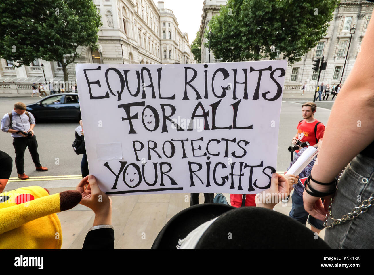 LGBT supporters protest opposite Downing Street demanding the British Prime Minister raise the subject of Russia's - Stock Image