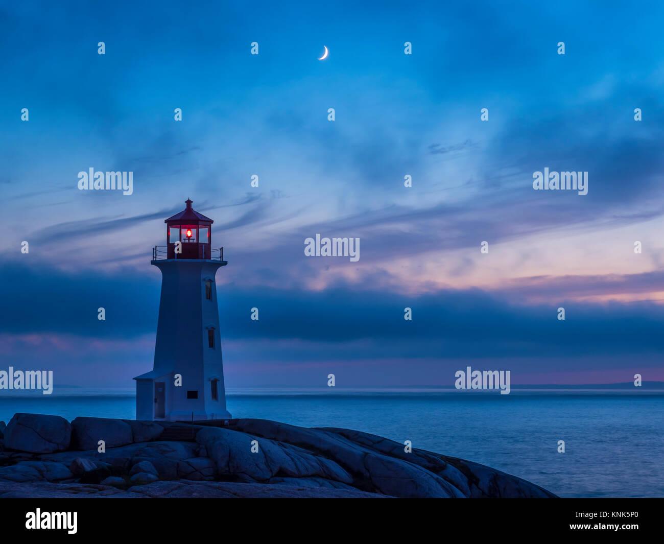 Crescent moon above Peggy's Cove Lighthouse, Peggy's Cove, Nova Scotia, Canada. - Stock Image