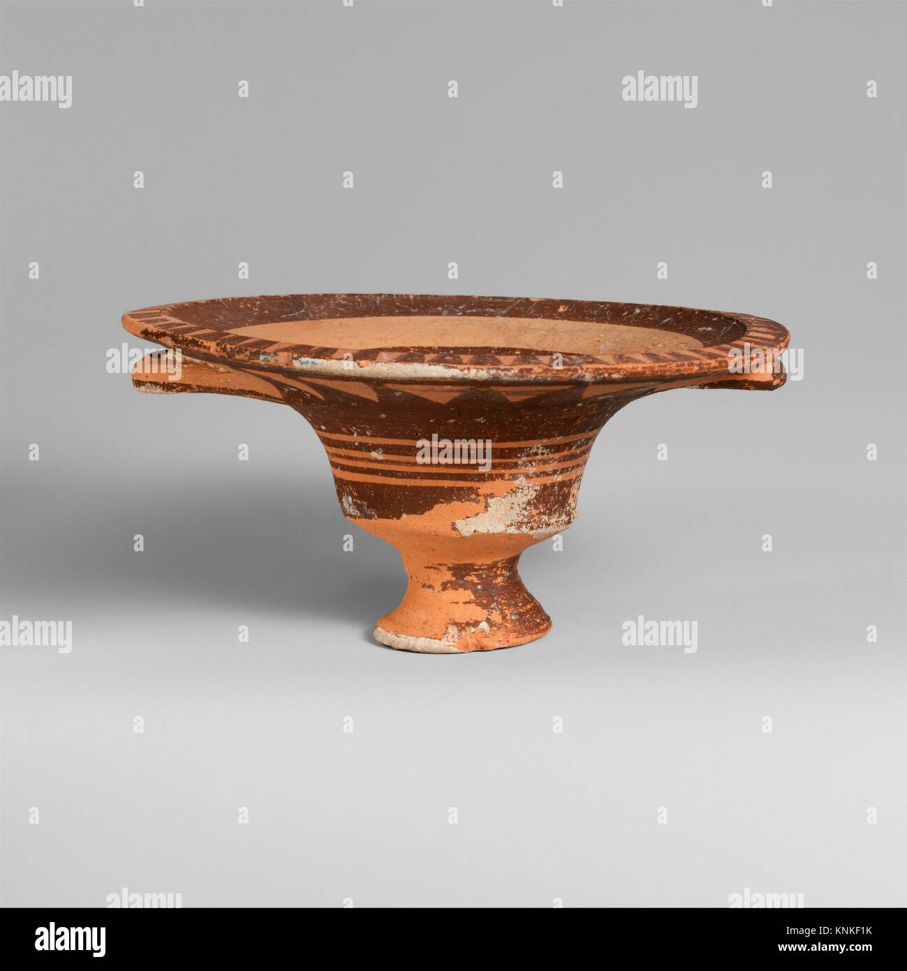 Terracotta stemmed dish with two handles. Period: Cypro-Geometric I; Date: 1050-950 B.C; Culture: Cypriot; Medium: Stock Photo