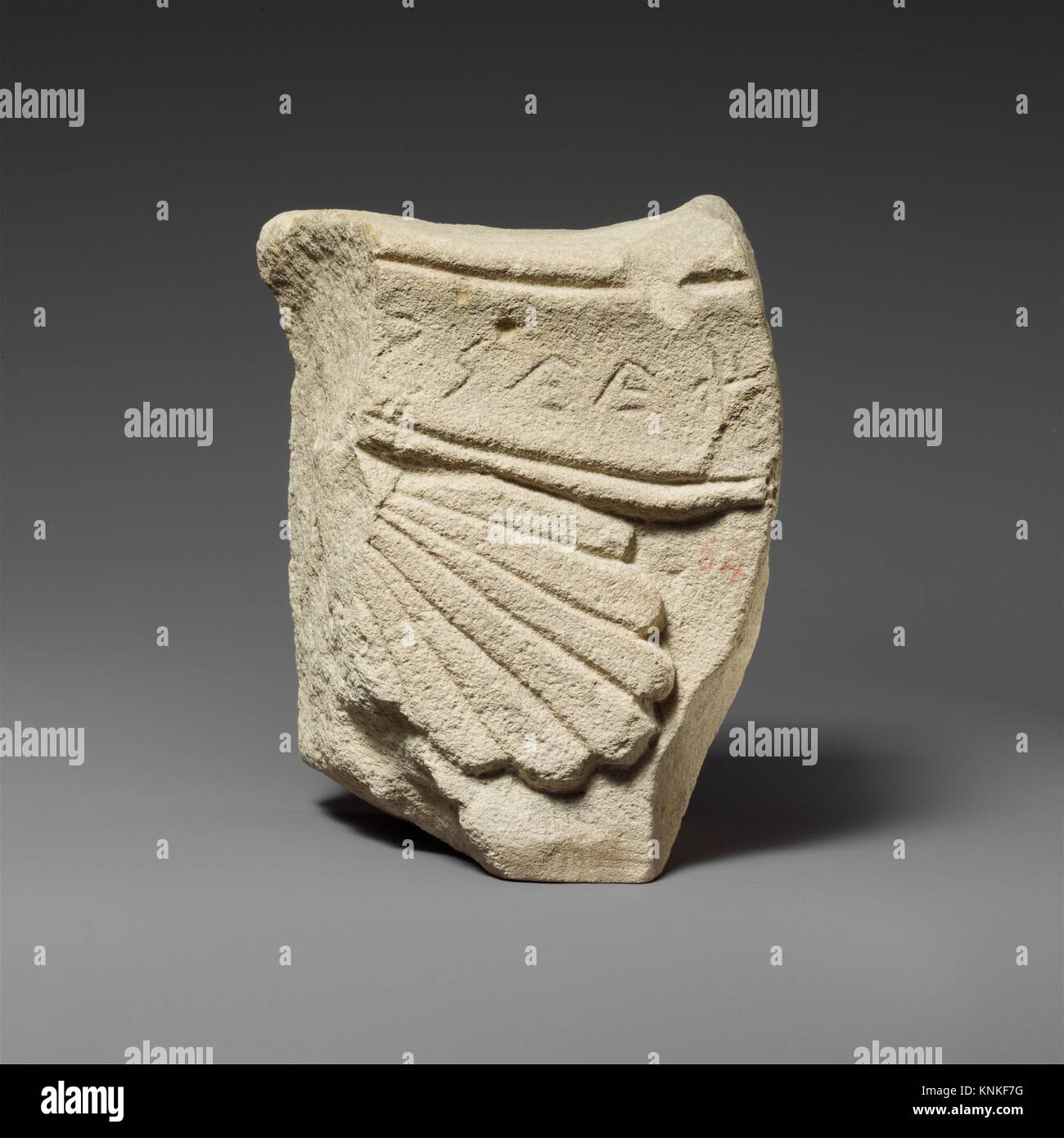Grave relief fragment, votive. Culture: Cypriot; Medium: Limestone; Dimensions: Overall: 4 1/4 x 5 5/8 x 2 1/4 in. Stock Photo
