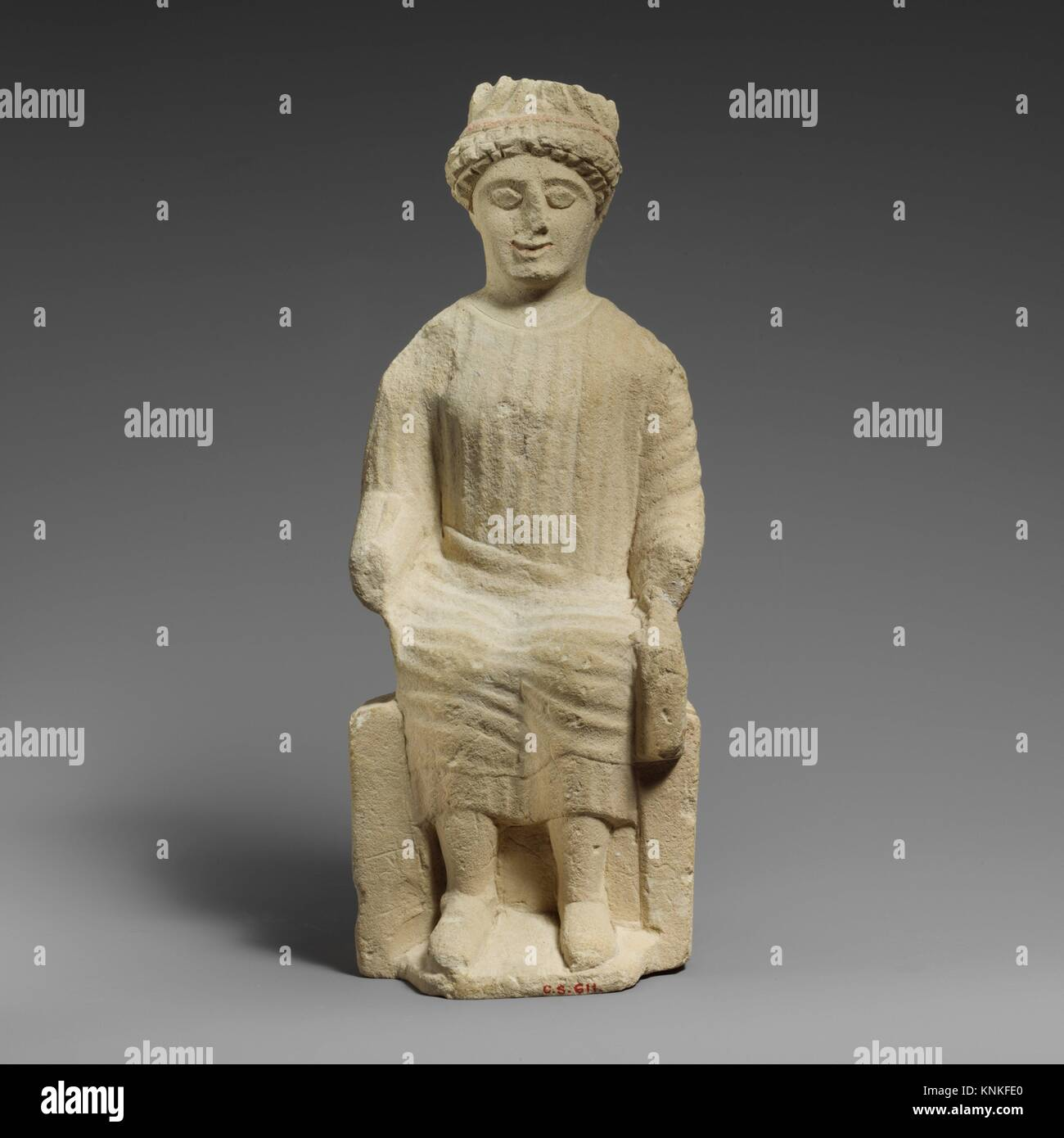 Limestone statuette of a seated beardless male votary. Period: Classical; Date: 2nd half of the 5th century B.C; Culture: Cypriot; Medium: Limestone; Stock Photo