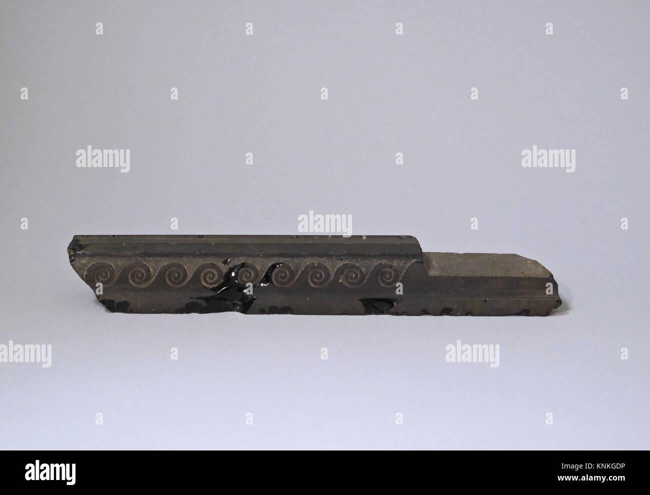 Obsidian furniture attachment. Period: Early Imperial, Augustan; Date: ca. 25 B.C.-A.D. 10; Culture: Roman; Medium: - Stock Image