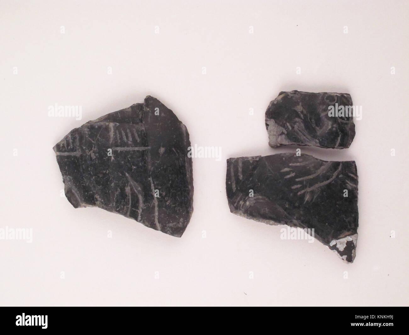 Vase fragment. Period: Archaic; Date: 570-550 B.C; Culture: Etruscan; Medium: Terracotta; bucchero pesante; Dimensions: Stock Photo