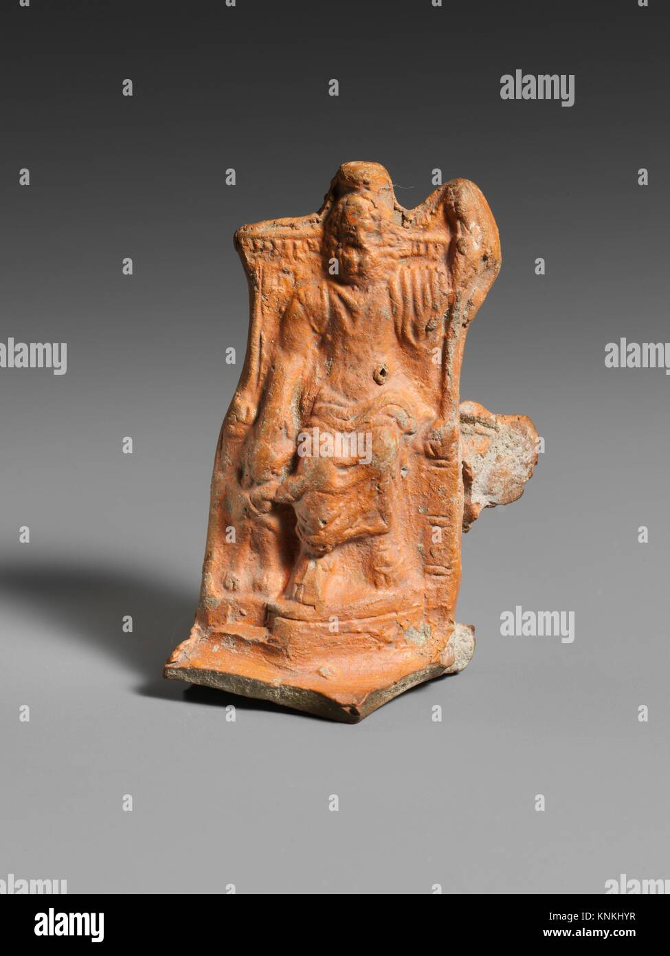 Terracotta lamp handle. Period: Imperial; Date: 2nd century A.D; Culture: Roman; Medium: Terracotta; Dimensions: - Stock Image