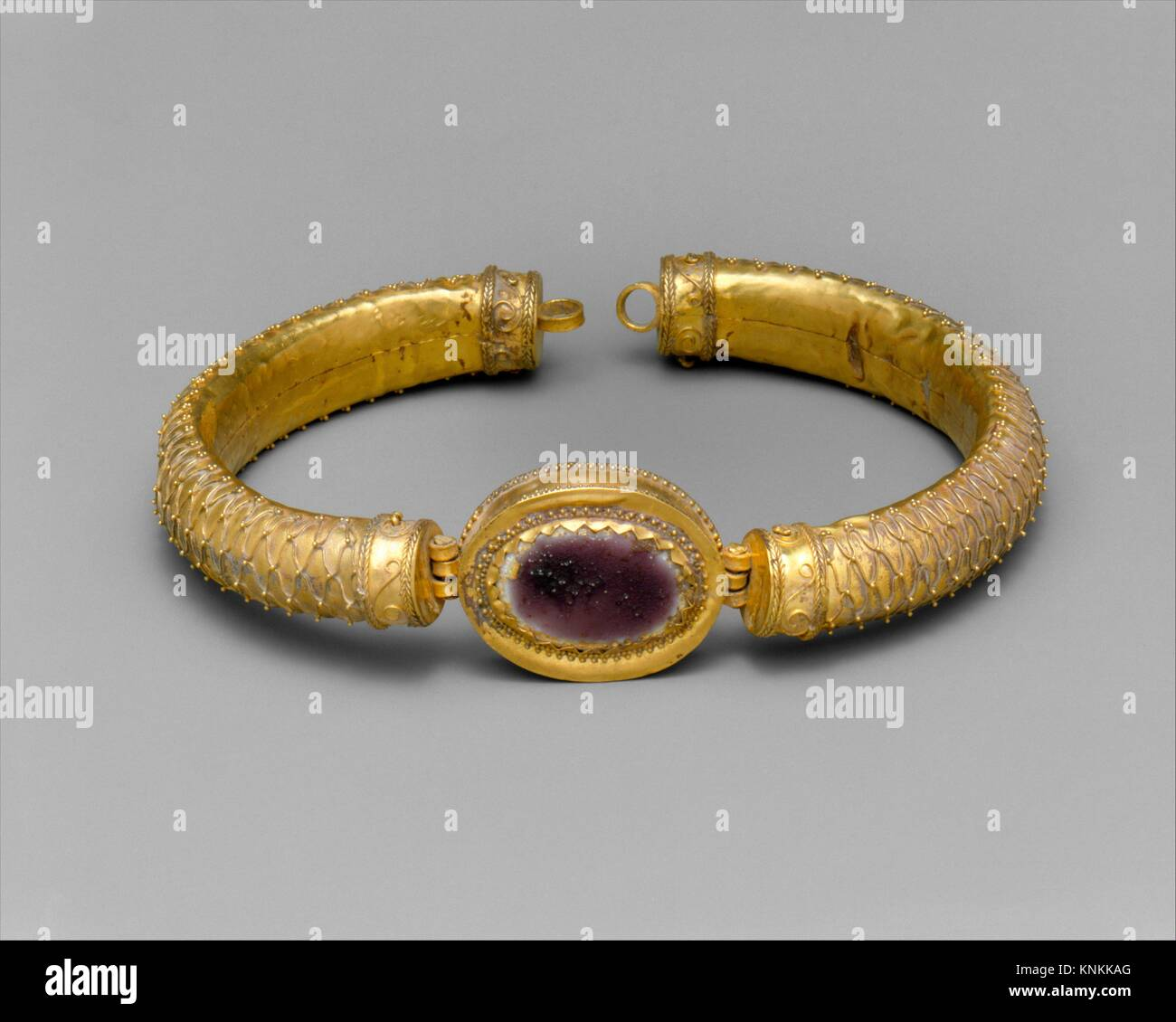 Gold and glass bracelet with central medallion. Period: Hellenistic; Date: 2nd century B.C; Culture: Greek; Medium: - Stock Image