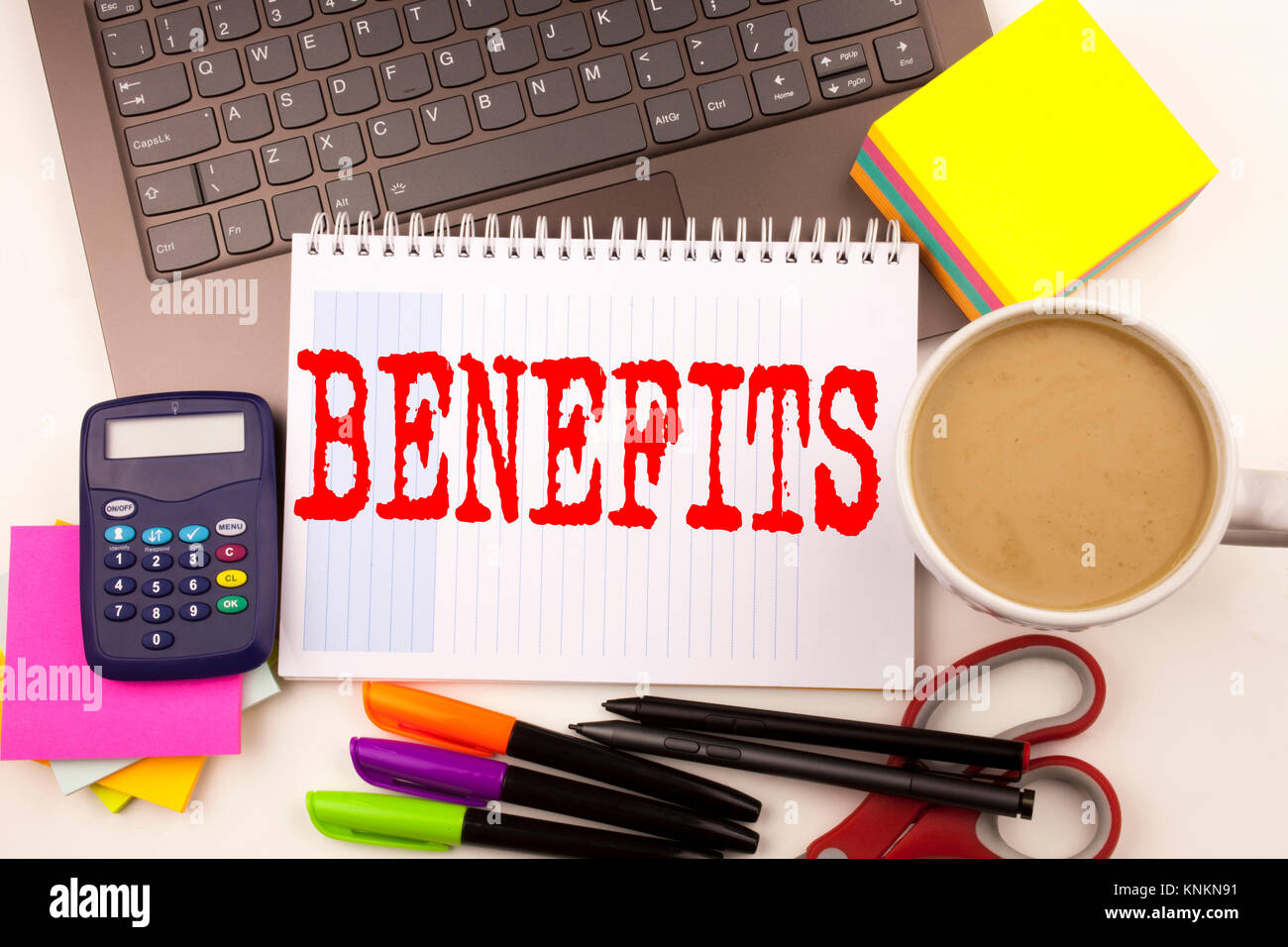 Word writing Benefits in the office with  laptop, marker, pen, stationery, coffee. Business concept for Bonus Employee - Stock Image