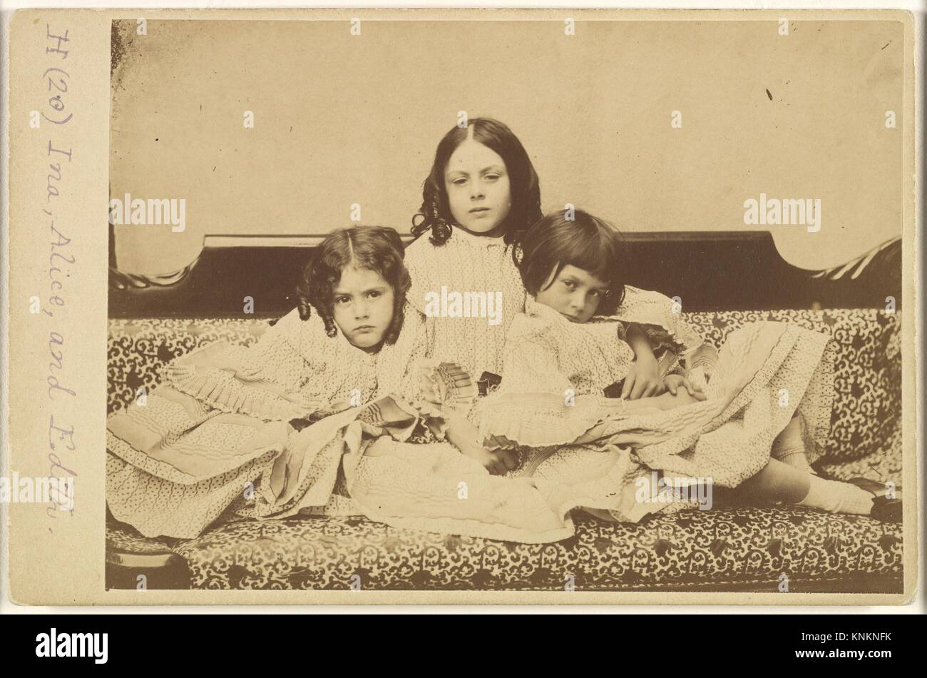Edith, Ina and Alice Liddell on a Sofa. Artist: Lewis Carroll (British, Daresbury, Cheshire 1832-1898 Guildford); - Stock Image