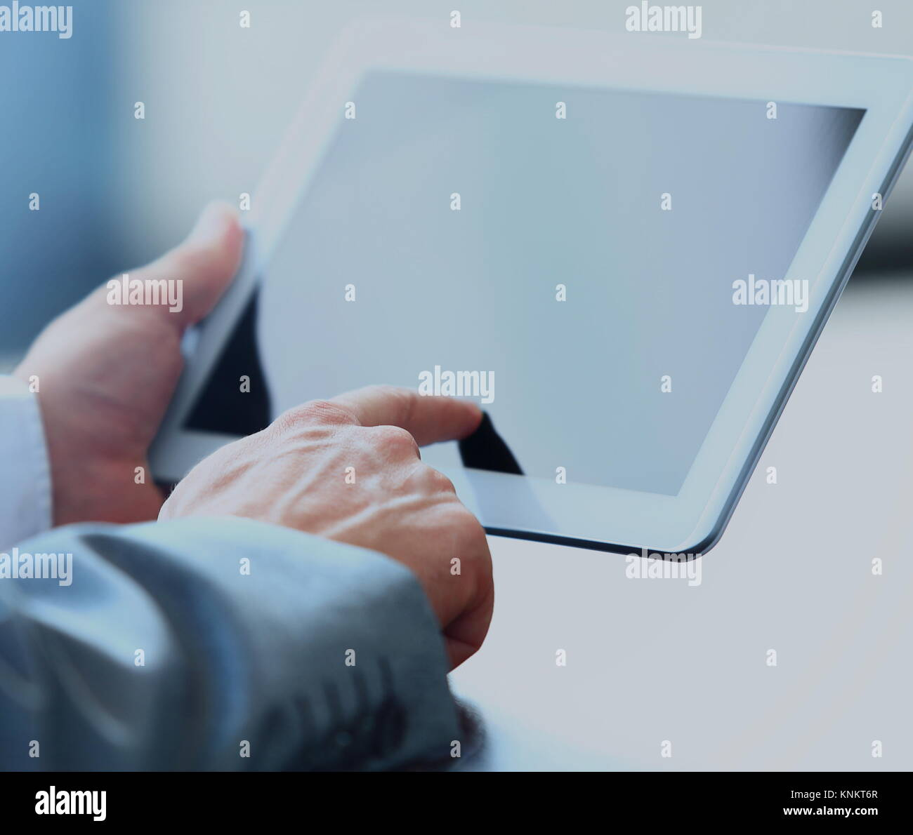 Businessman holding digital tablet - Stock Image