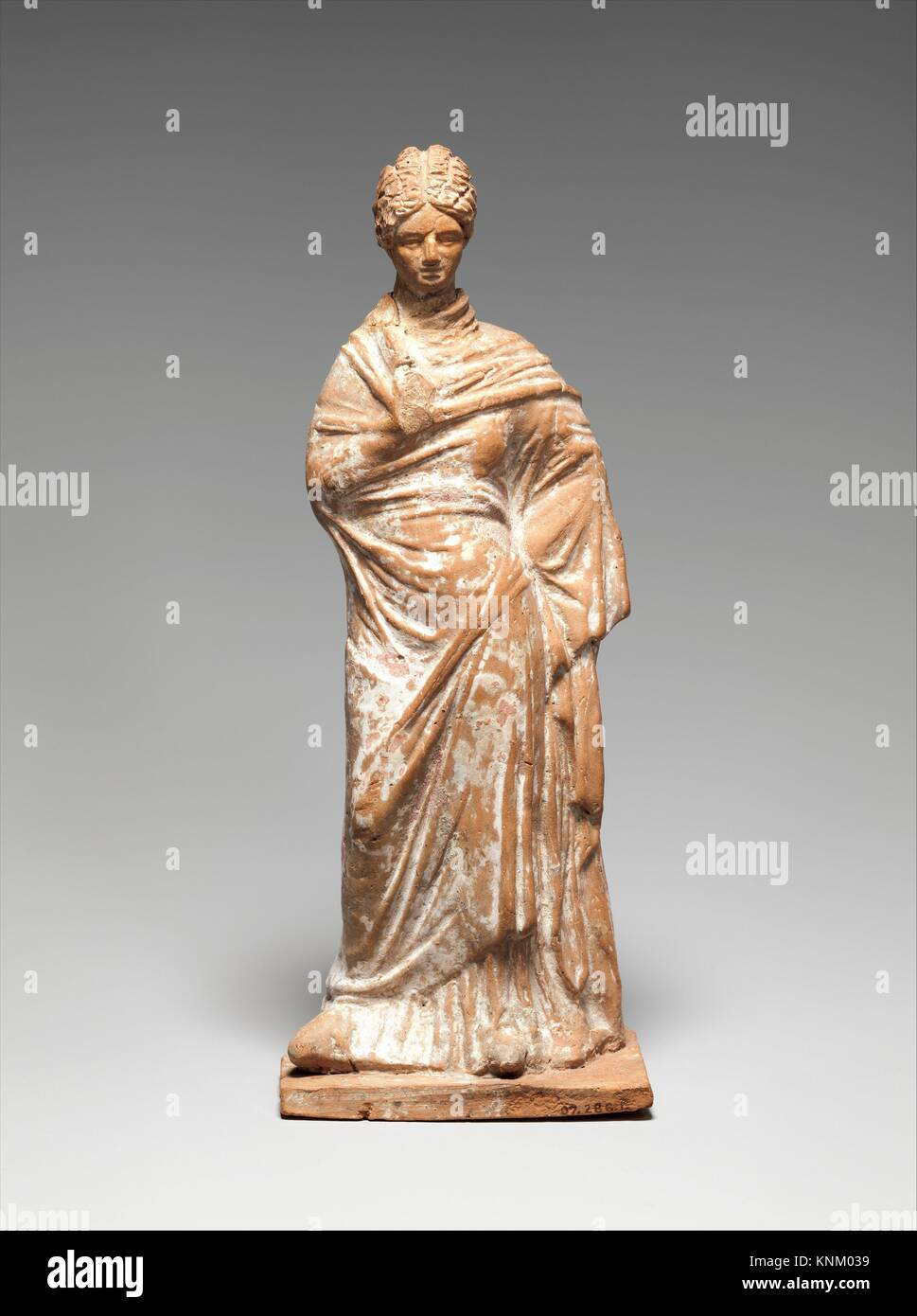 Terracotta statuette of a standing woman. Period: Hellenistic; Date: late 4th-early 3rd century B.C; Culture: Greek, - Stock Image