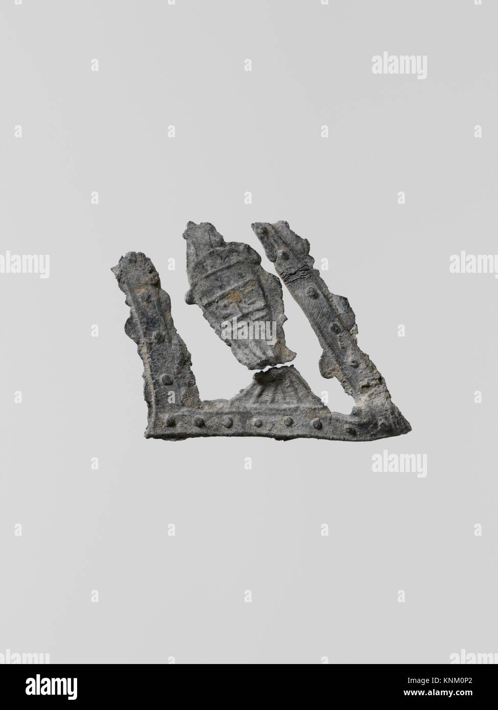 Ornaments, 14. Culture: Greek, Laconian; Medium: Lead; Dimensions: Height: 1 3/16 in. (3 cm); Classification: Miscellaneous Stock Photo