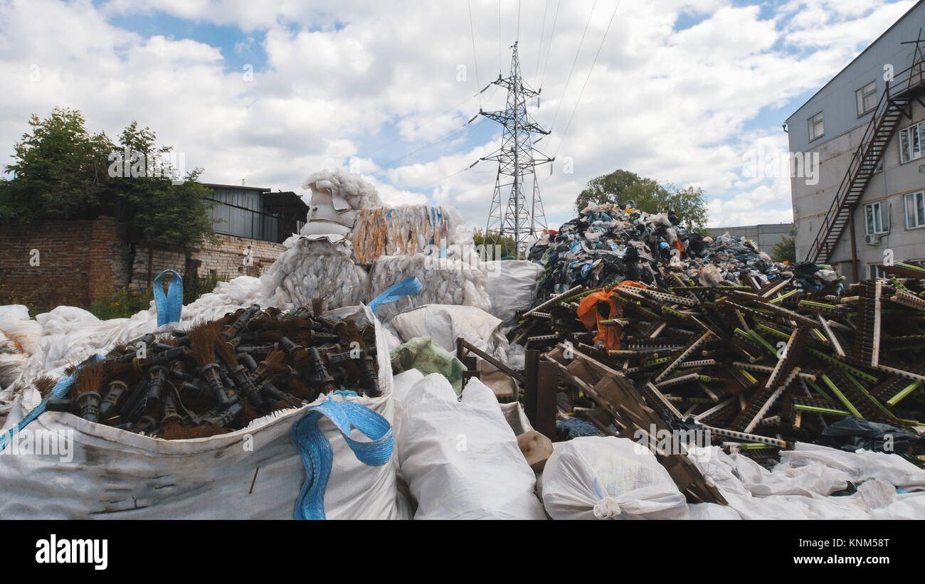Large heaps of plastic canisters and boxes, ecology concept Stock Photo