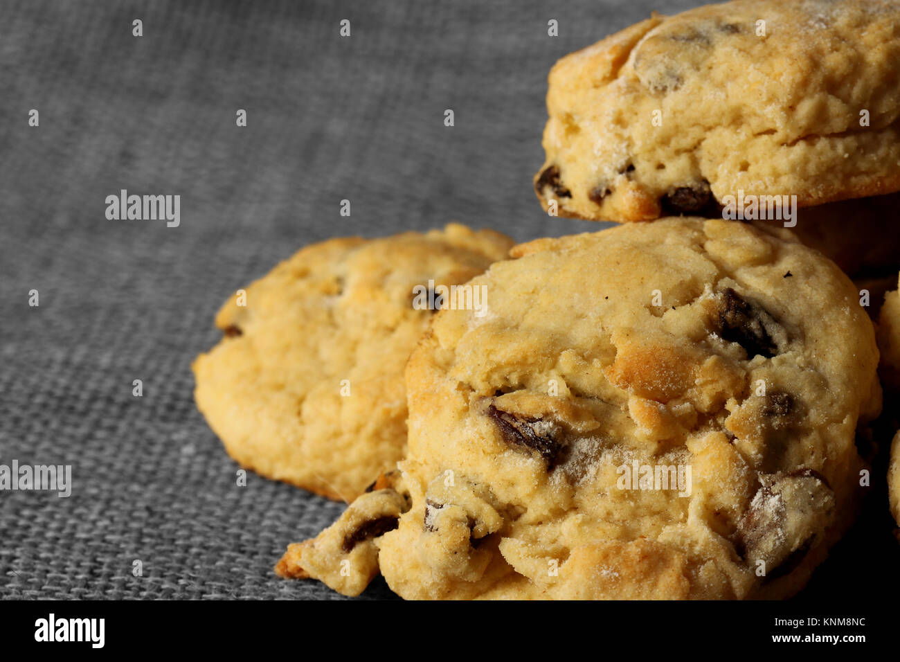 Homemade fruit scones on a hessian background - Stock Image