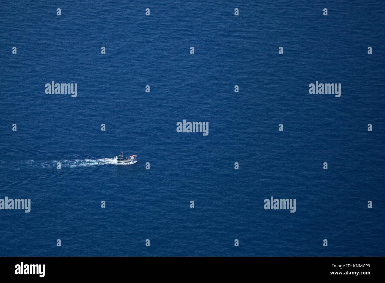 Fishermen on Fisherboat on the Atlantic Stock Photo