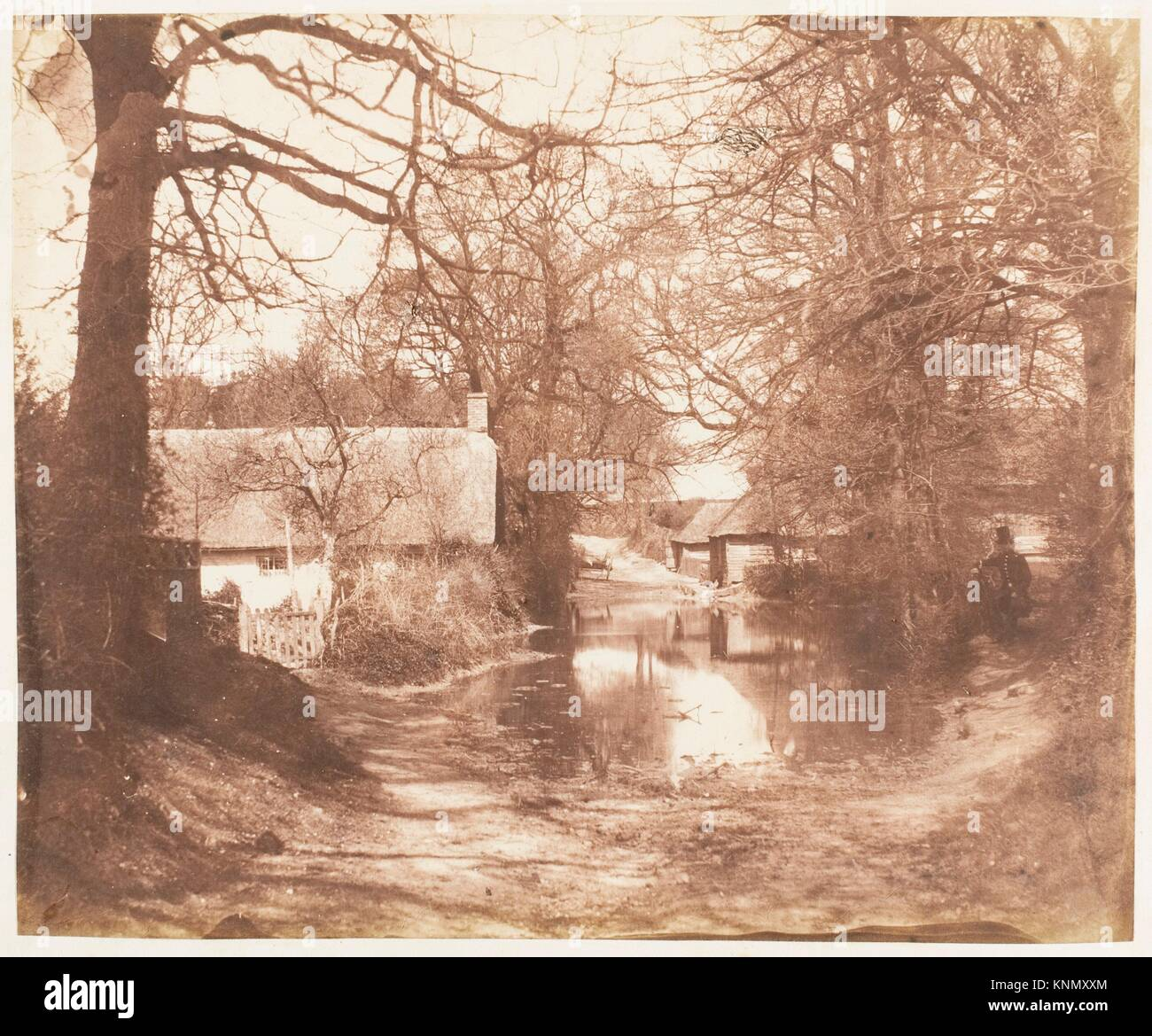 [View of a House in the Woods, with a Waterlogged Road]. Artist: John Dillwyn Llewelyn (British, Swansea, Wales Stock Photo