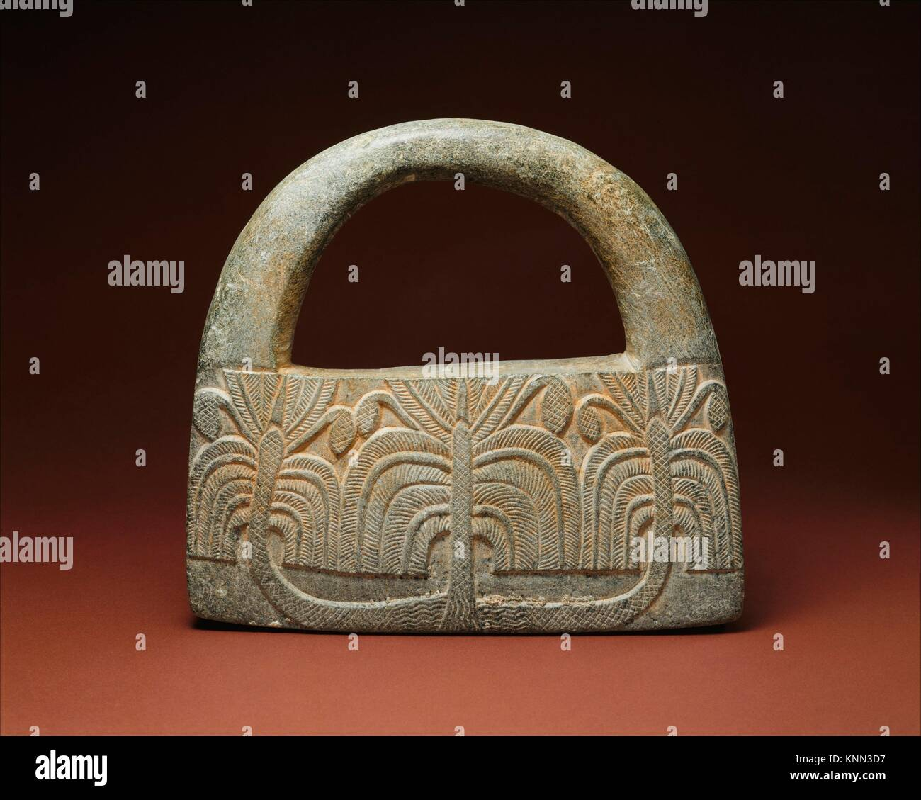 Object with a handle, perhaps a weight; palm trees and guilloche. Period: Early Bronze Age; Date: ca. mid- to late - Stock Image