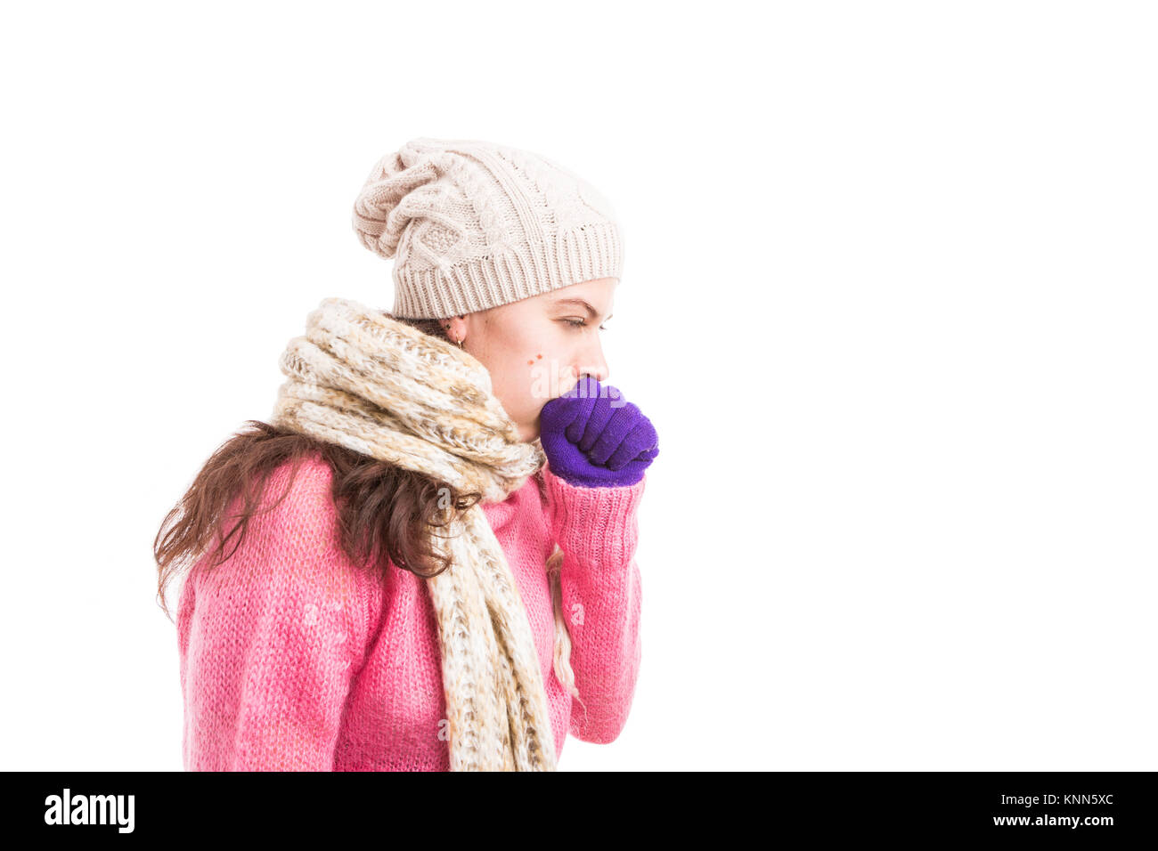 Sick woman with scarf and hat couching as influenza virus concept isolated on white background with copy and text - Stock Image
